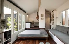 Man Builds Modern 210 Sq. Ft. Tiny Home. Love the windows and the bed that slides out from under a raised floor. No loft!