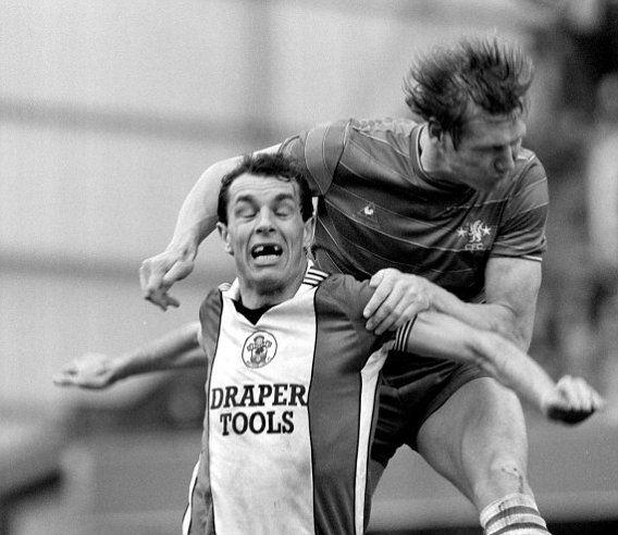 "Joseph ""Joe"" Jordan (Southampton FC, 1984–1987, 48 apps, 12 goals) battles with Douglas 'Doug' Rougvie (Chelsea FC, 1984–1987, 74 apps, 3 goals) in their Canon League Division One meeting, at Stamford Bridge, London."