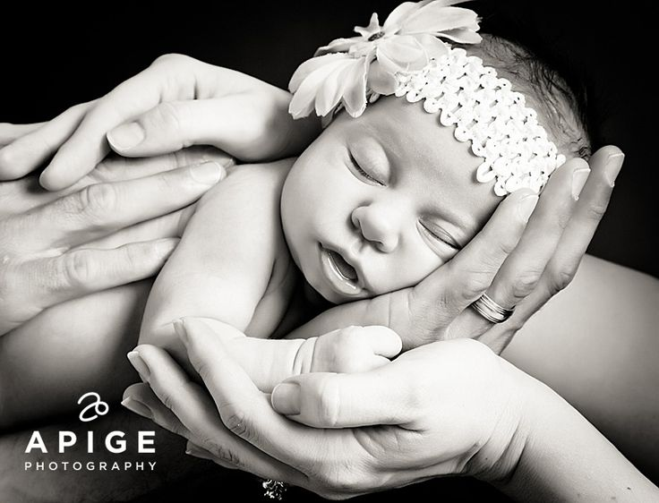 I love this pose for pictures on newborn babies!  I have had it done with both of my girls now!