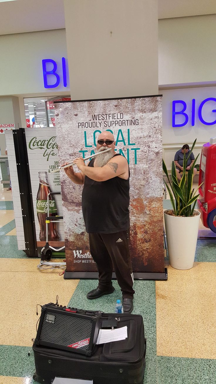 This guy plays the flute at shopping malls near me.