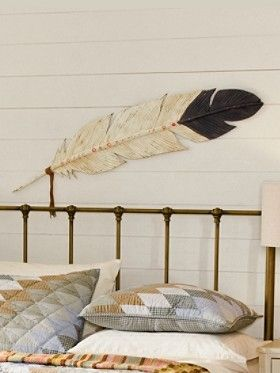 Feather. Native American decor. Maybe wood burn a feather on one of my large driftwood pieces.