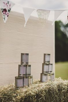 Tin can alley garden game - Image by Lola Rose Photography - Pronovias 'Lary' wedding dress for a vintage inspired wedding in a country house with garden games, 1930s gramophone music & pink colour scheme