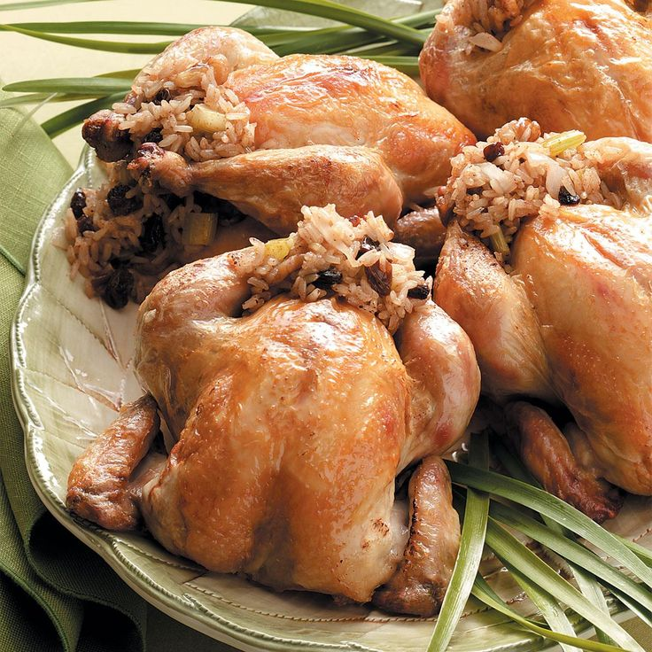 Cornish Hens Stuffed with Rice Recipe -These moist golden hens are a tradition at our house on Christmas Eve. We think the spiced rice stuffing with cinnamon, sweet raisins and honey goes so well with the birds and makes the meal a special one. -Dorothy Anderson, Ottawa, Kansas