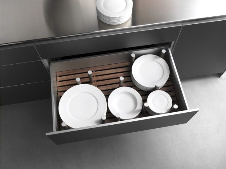 Bulthaup - deep drawer with pegs for plate storage.