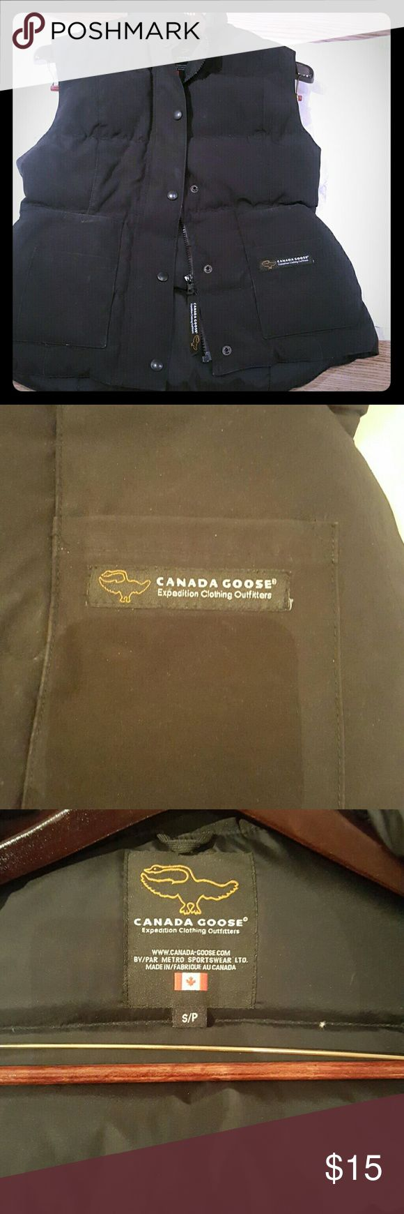 Authentic Canada Goose down vest Pre-owned discounted to sell as is, chalk like mark on front and bag, but still good condition and very warm! Canada Goose Jackets & Coats Puffers