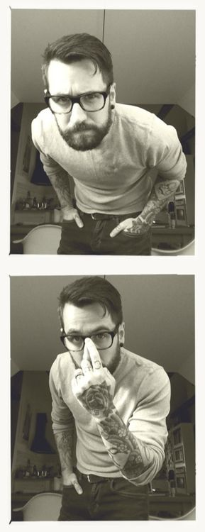 Besides the fact that this is a full grown man taking selfies... His beard, tattoos, and glasses make up for that. Adorable(: