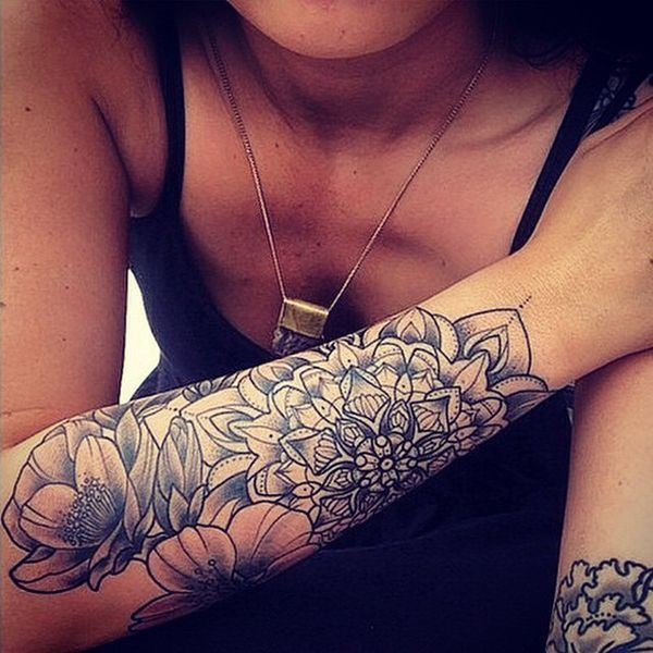 mandala style and flowers tattoo on lower arm