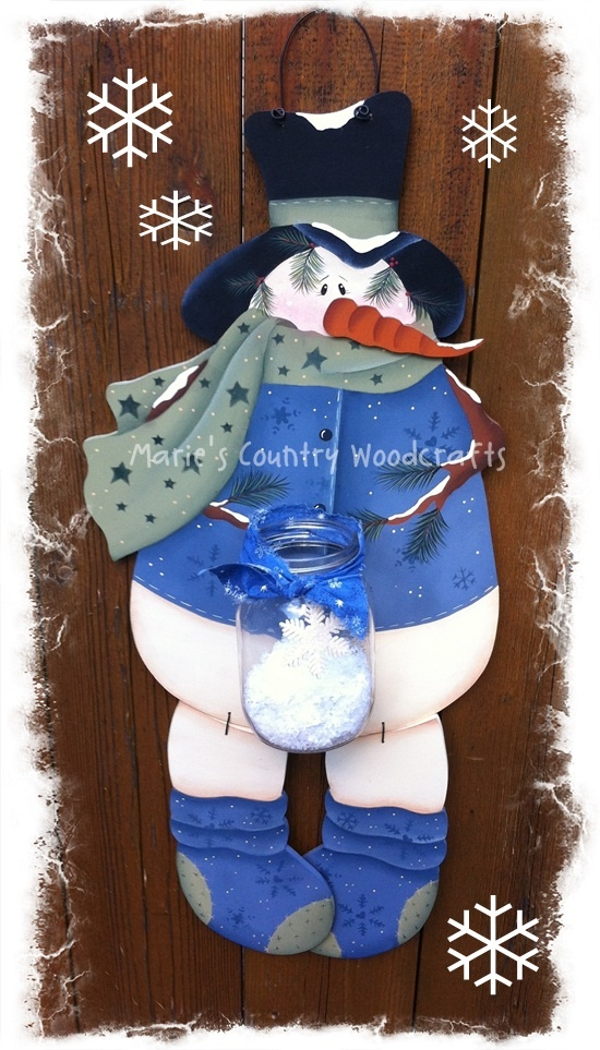 Designed by Reneé Mullins and painted by me. Snowman holding a jar of snow.