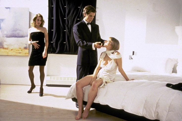 """American Psycho"" movie still, 2000.  L to R: Krista Sutton, Christian Bale, Cara Seymour."