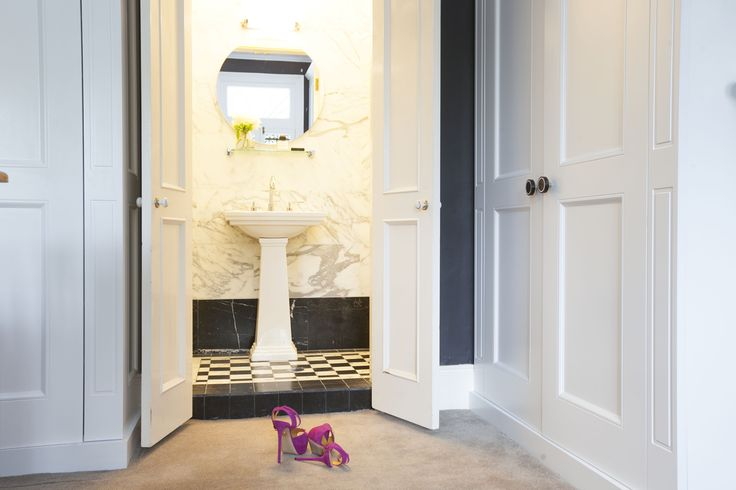 Black and white marble bathroom. Charlotte Olympia shoes. Design by Sarah Blacker Architect. Photo Anneke Hill.