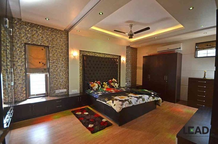 Master bedroom with posh interiors design by living edge for Master bedroom designs in india