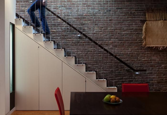 Staircase Design from an apartment in New York. The designer Juan Matiz of Matiz Architecture & Design worked with a New York family to link their apartment to an outdoor terrace. - More storage is designed to fit underneath the steps. The metal cables provide stability for the cantilevered stair and serve as rails at the same time. | #Staircase #InteriorDesign #Interiors |