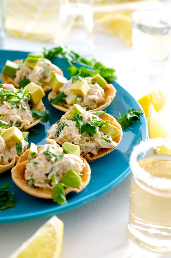 Spicy Little Muffin Tin Chicken Tostadas - mini tostadas made from tortillas baked in a muffin tin and filled with a zingy chicken filling. Great make ahead and fast to prepare!