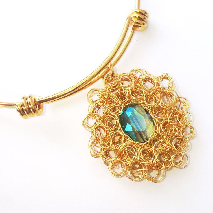 A personal favorite from my Etsy shop https://www.etsy.com/listing/533279751/gold-filled-wire-woven-crystal