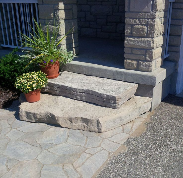 Random Natural stone steps with Permacon Mega Arbel paver