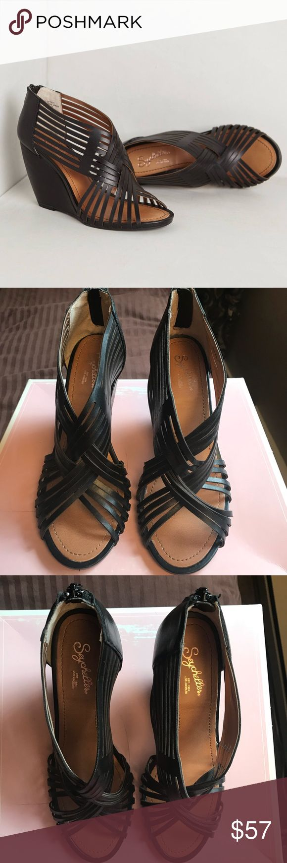 Seychelles black wedge sandals Beautiful black leather sandals with wedge and back heel zippers. Seychelles Los Angeles  Small scuff on heel as pictured. Hardly worn Smoke free and pet free home Seychelles Shoes Wedges