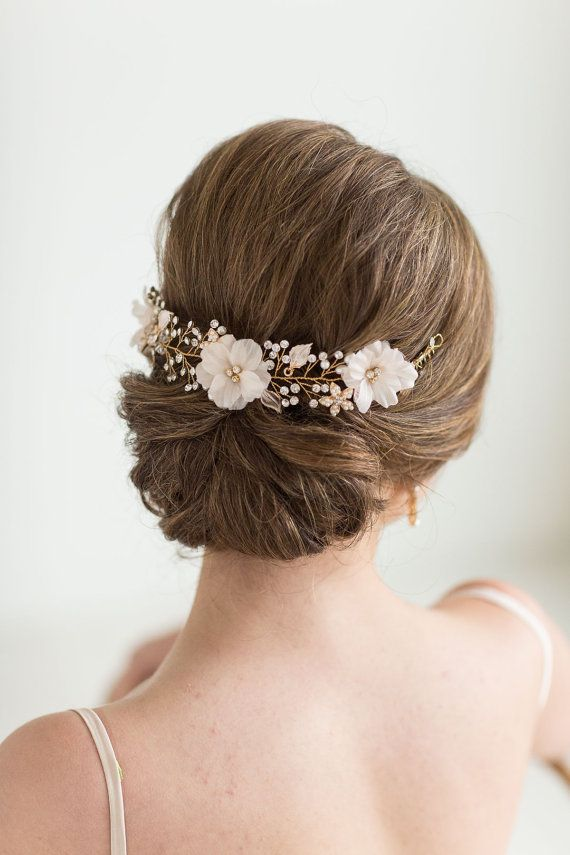 A pretty floral hair vine for your wedding day hair. Handcrafted by twisting wire to individually add every single flower, leaf, crystal,