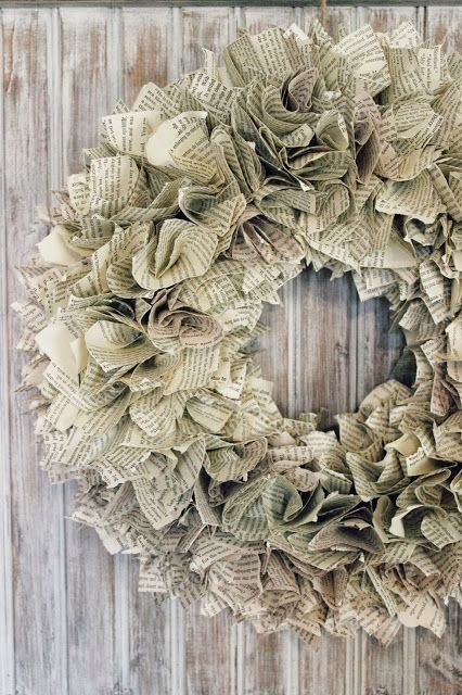 """Book page wreath; successfully did this using probably 400, 4"""" squares (just cut the page in half) on a 16"""" foam wreath. Could try smaller squares on a smaller wreath form, and lighter weight craft paper (not construction or tissue paper) in different colors to mix it up."""