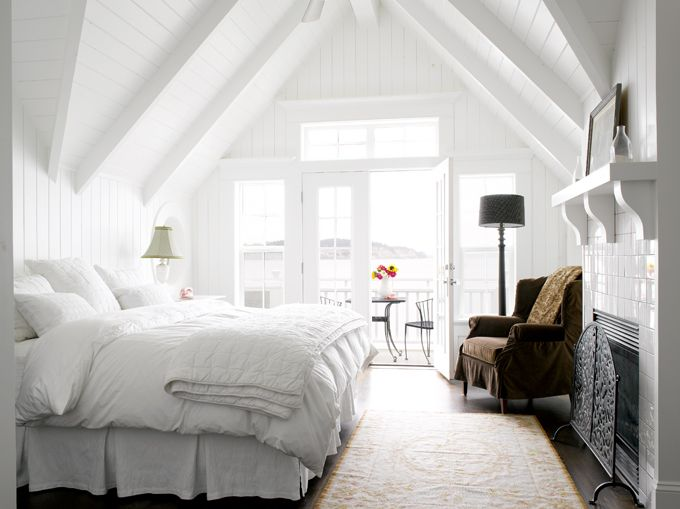 I just love beds like this. Huge, high and piled with pillows.