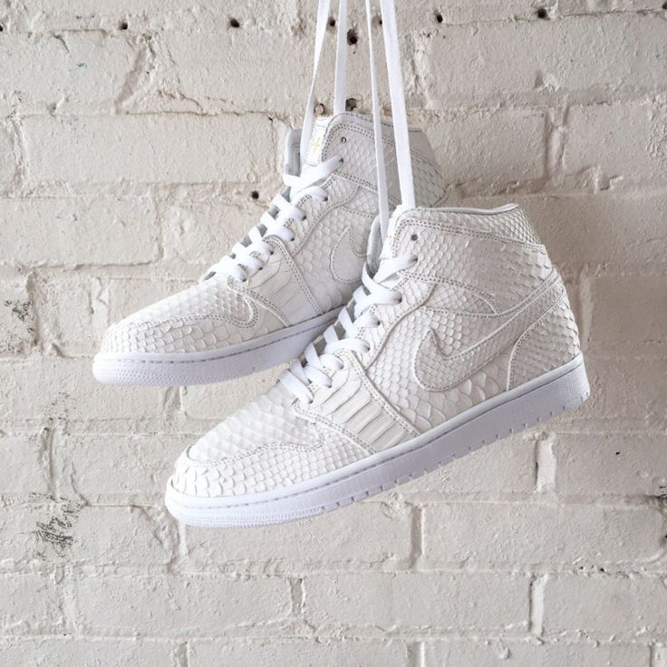Check out this all-white Air Jordan 1 covered in python done by JBF Customs