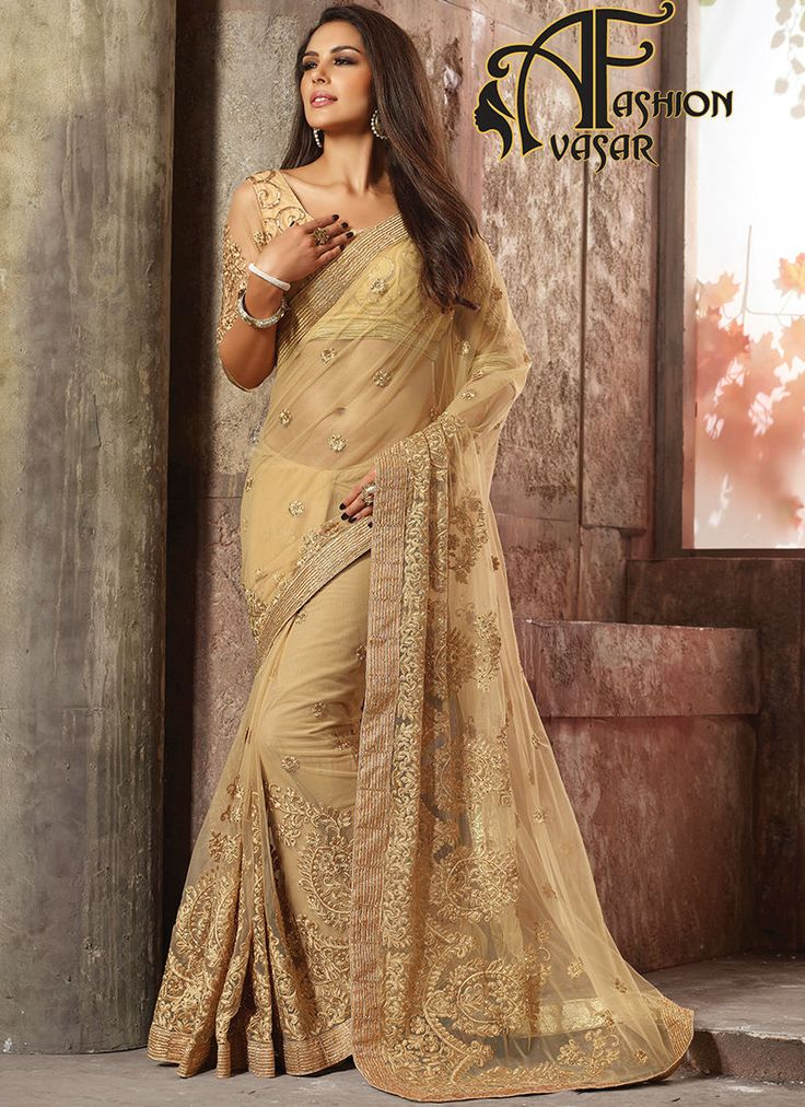 Suede Cream Net Saree With Blouse.Add grace and charm on your look in this stunning Dark Cream Net Saree. The ethnic Lace & Resham work at the clothing adds