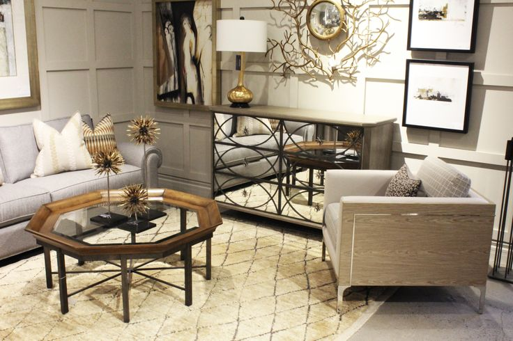 http://www.avenuedesigncanada.com rustic contemporary table, contemporary armchair with silver inlay, mirrored dresser.