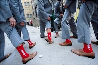add a little color into your wedding with the groomsmen socks!