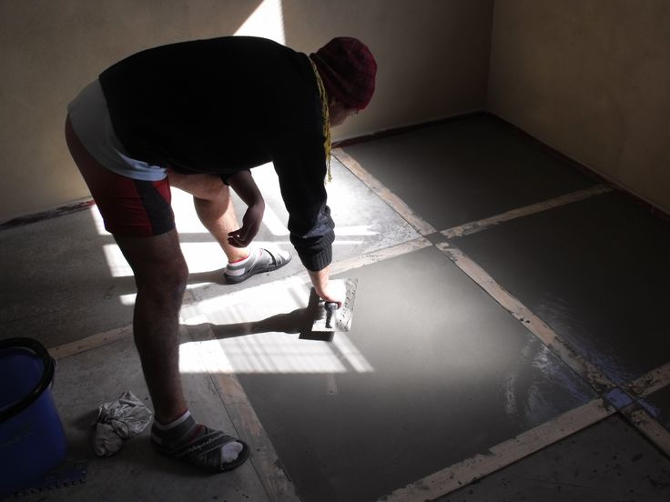 Me busy with concrete flooring for my bedroom.