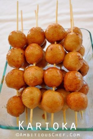 "Carioka/Karioka is a deep fried rice glutinous flour ball coated with caramelised sugar on a skewer. This is the reason why the Ilocanos call it ""tinodok or tinuduk"". It is sweet and crunchy on the outside and chewy on the inside. It is also a popular street food and very good for meryenda or snack. … … Continue reading →"