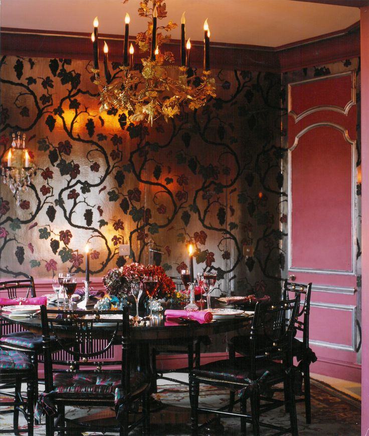 Dining Roon with a vine and grapes hand painted onto the walls.
