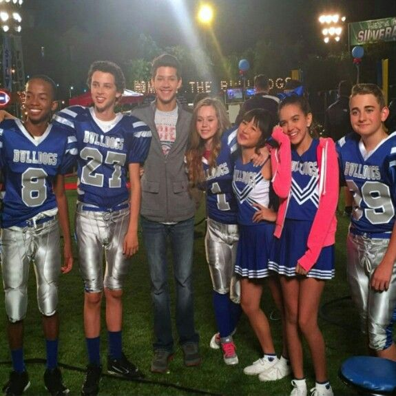 On set of nickelodeon's newest show bella and the bulldogs (who's the guy in the middle...lol!)