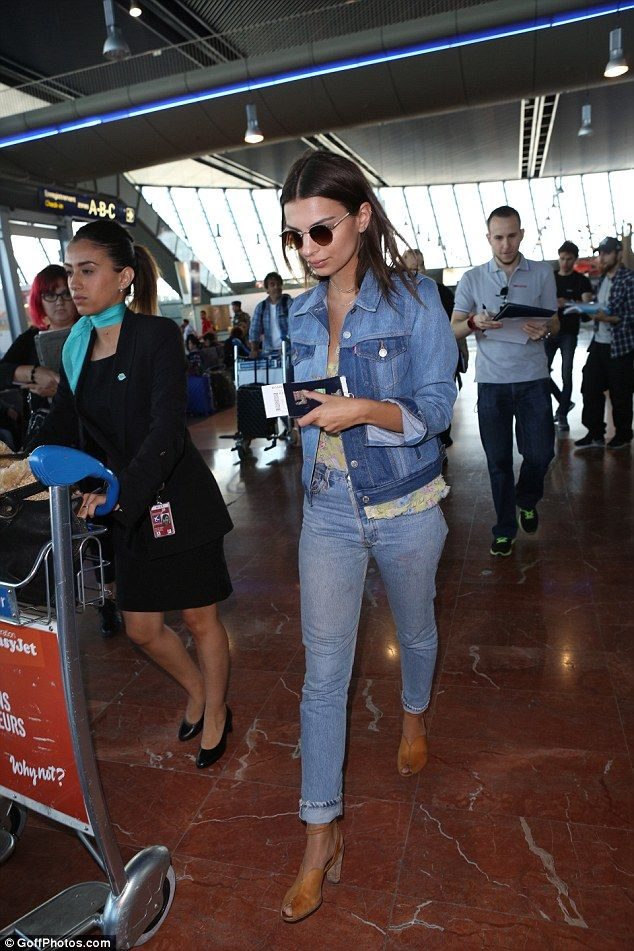 Denim days: Emily Ratajkowski's appearance at the 70th Cannes Film Festival was simply a flying visit as she was pictured jetting out of Nice airport on Friday