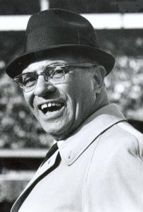 Every year the winner of the Super Bowl hoists the Lombardi trophy above their heads. The trophy is named for Vince Lombardi, a famous coach of the Green Bay Packers. Lombardi's teams won the first two Super Bowls.
