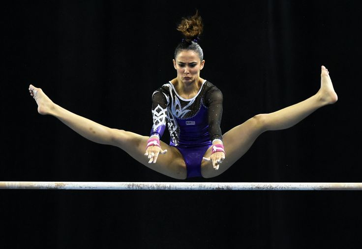Malaysia's Farah Ann Abdul Hadi competes on the uneven bars during the women's individual all-around... - Provided by AFP