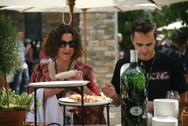 Guests enjoying wood-fired pizza paired with Silver Oak's wine at Silver Oak Winery Cabernet Release Day, August 2011.