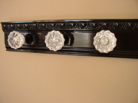 Beautiful coat rack with 3 glass door knobs and decorative beveled moulding