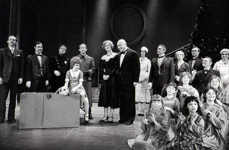 Christmas party at Warbucks' mansion, Annie, 1977, public domain via Wikimedia Commons.