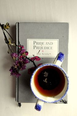 'Pride & Prejudice' and a mug of something warm that tickles your fancy... Only thing missing is cake!