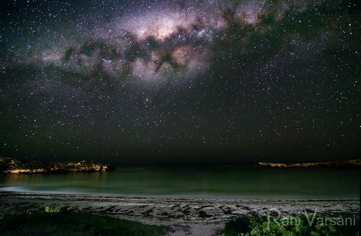 The Milky Way sets over a bay in Australia.