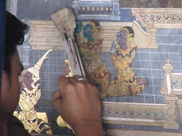 Contemporary Artist restoring the ancient work of the Temple of Dawn, Thailand.  2007