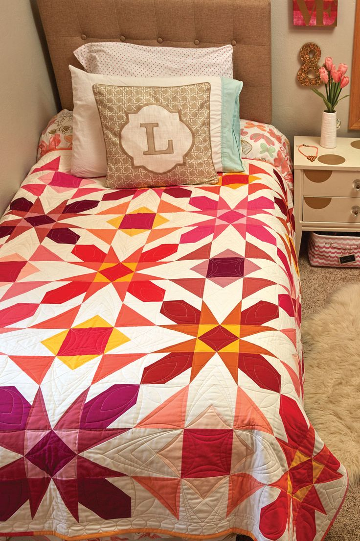 SWEET PEA by Kristin Lawson: Make this innovative design using your favorite solid colors — quilt blocks in vibrant solids make this bed-size quilt pattern sing! Piecing is fast with these oversized block units. Use your favorite colors to create a bold, one-of-a-kind quilt with great movement and personality in the scrap quilt pattern.