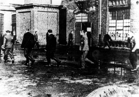 Radogoszcz, Poland, 1940, Prisoners running around the jail yard.
