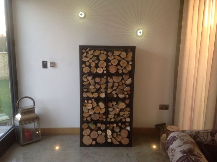 Indoor log store...... Thanks to IKEA shelves!  £55....... Looks great!