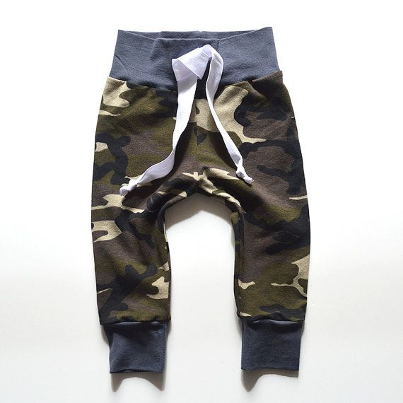 Your trendy tot will look adorable in these camo print joggers with grey accents! Made from a soft jersey knit with drawstring detail.