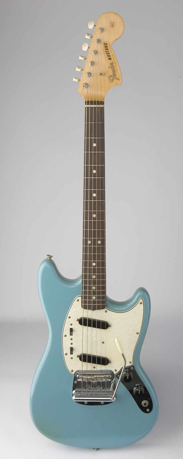 "Fender Mustang - My first electric and unfortunately, loooong gone. A '65 ""clean one owner"" I inherited from my brother...I am an idiot."