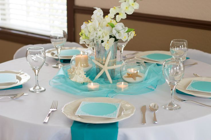 Beach Bliss Wedding Reception Table, Blue, Turquoise, white, organza, starfish, shells, sand, candles, menu, twine Concept and Design by A Dream 2 Reality Events Inspire.Design.Plan with Style Photography by J.Gray photography