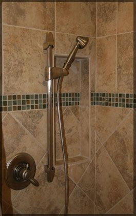 beige bathroom diagonal tile with accent strip