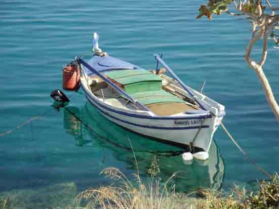 Fishing boat moored at the southermost end of Karathona Beach, Nafplio - Greece