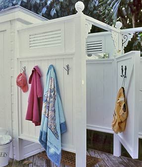 Outdoor shower by pool...love the hooks on the outside and inside.  Like the door, too.
