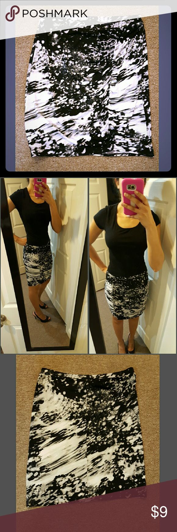 Black and white skirt- never used Apostrophe black and white skirt, never used. Good for going out or can dress it up to look professional. Apostrophe Skirts Pencil